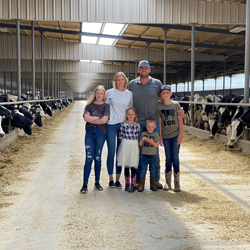 the Diepersloot family in their barn