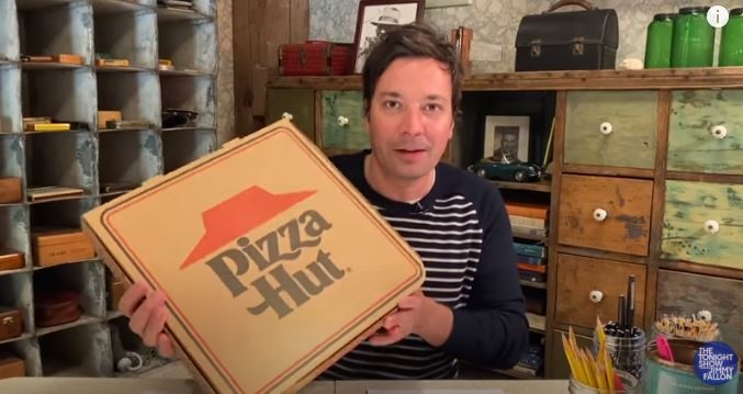 Jimmy Fallon with a box of Pizza Hut pizza