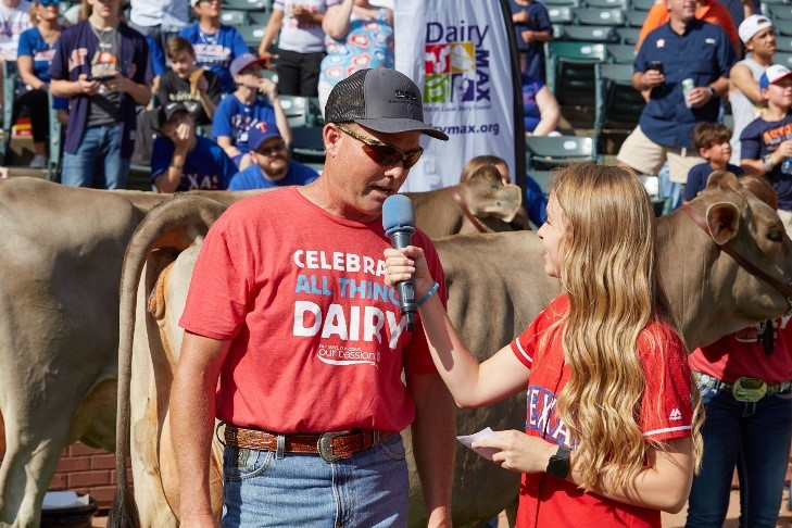 dairy farmer being interviewed at a Rangers game