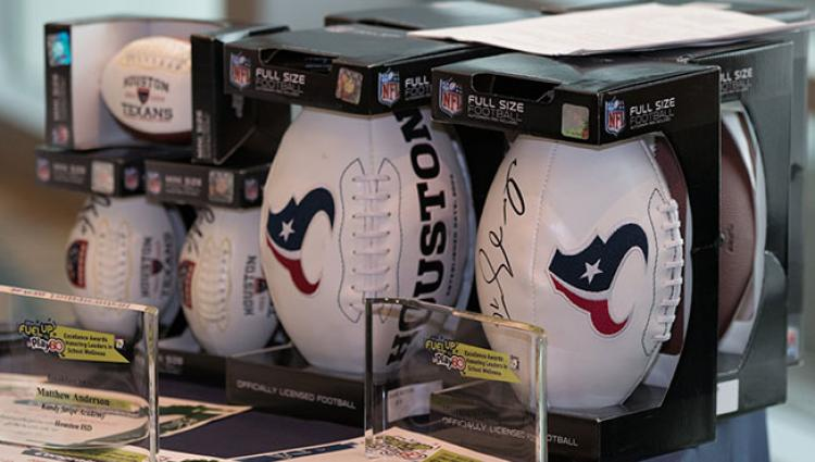 signed Texans footballs