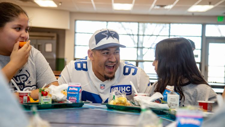Tyrone Crawford having breakfast with kids and laughing