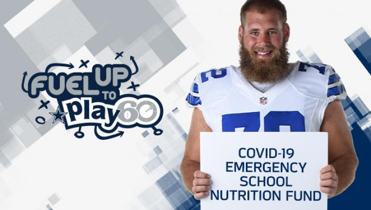 "Travis Frederick with a sign that says ""COVID-19 Emergency School Nutrition Fund"""