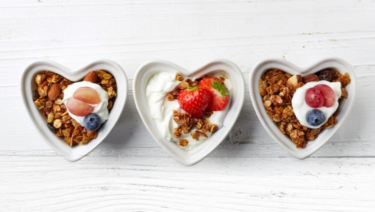 three heart shaped dishes of food