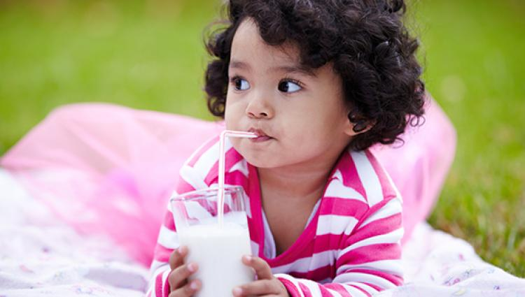 young child drinking milk