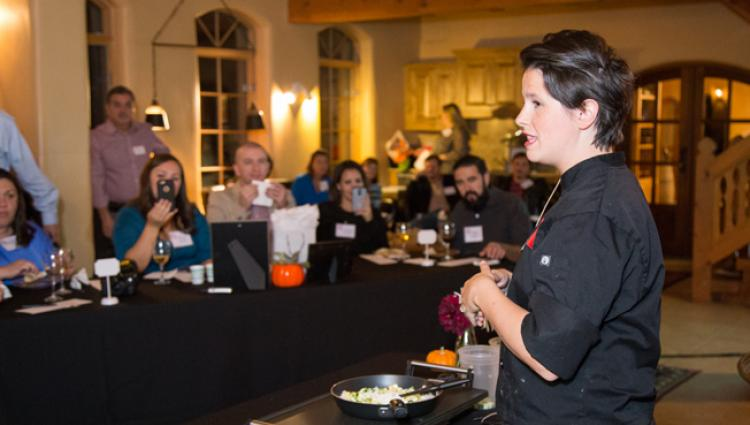 chef caitlin speaks to a group