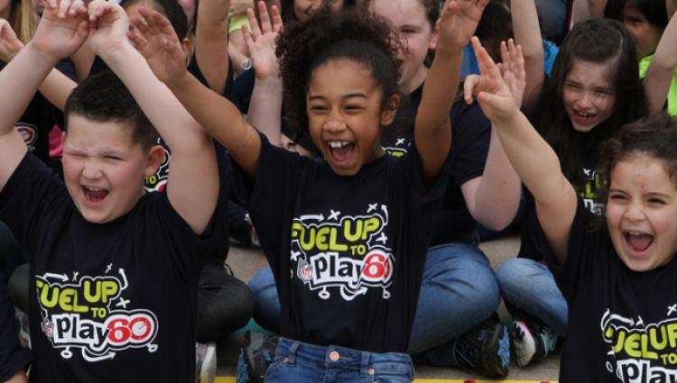 kids in fuel up to play 60 shirts cheering